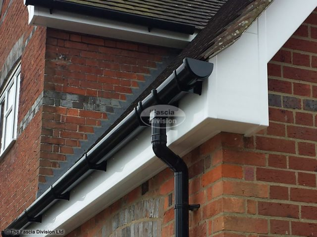 White fascia and soffit, black deep round guttering