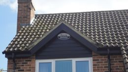 Installation of new black ash fascias soffits guttering cladding rooftrim black downpipe