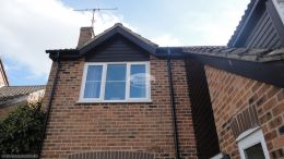 Thatcham Newbury recent full replacement rooftrim black ash fascias soffits and guttering downpipe