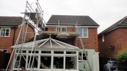 White replacement fascias soffits and guttering Eversley brown guttering downpipe