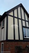 installation of new mock tudor beams with cream render board