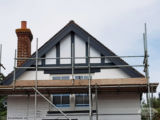 Installation of anthracite grey UPVC bargeboards and trims
