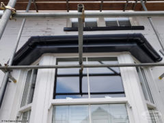 Installation of anthracite grey UPVC fascia, soffit and guttering around bay window