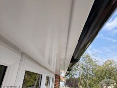 White UPVC soffit and fascia with black guttering in Basingstoke