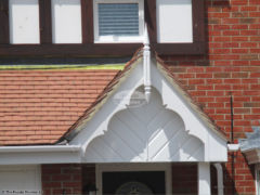 White decorative bargeboards roof spire herringbone cladding