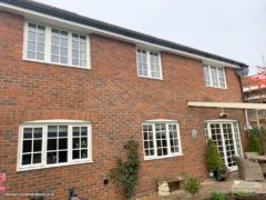 Black ogee guttering with white fascias and soffits